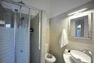 standard triple room anixis studio bathroom